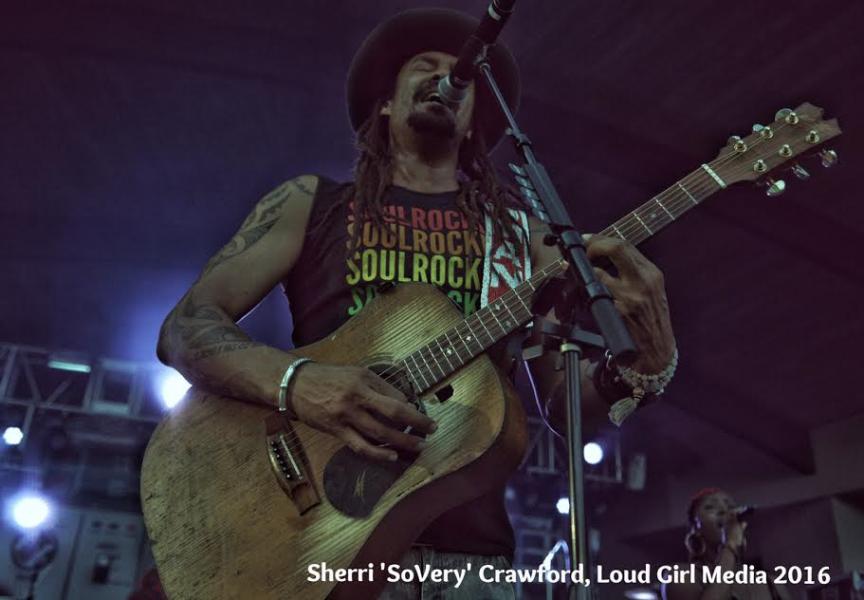 Michael Franti performs at Greenfield Lake Amphitheater in Wilmington, NC - July 2016. Photo: Sherri Crawford, Loud Girl Media